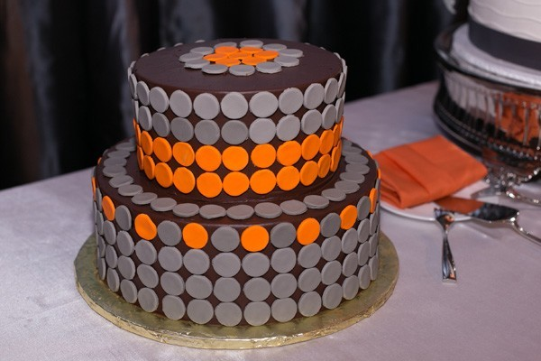 groom's cake with orange and grey dots